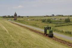 The Dagebüll 900 mil Werksbahn tp the Halligen Oland and Langeness hear leaving the main land at Dagebull. Schoma lok on 17 July 2014