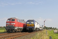 DBS 218-344 heading a Sylt bound IC passing NOB local pushed by MAK DE2700-08 on 17 July 2014 near Risum-Lindholm