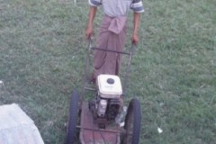 aphv-1413-030227-myanmar-mandalay-royal-palace-local-made-lawn-mower--27-2-2003